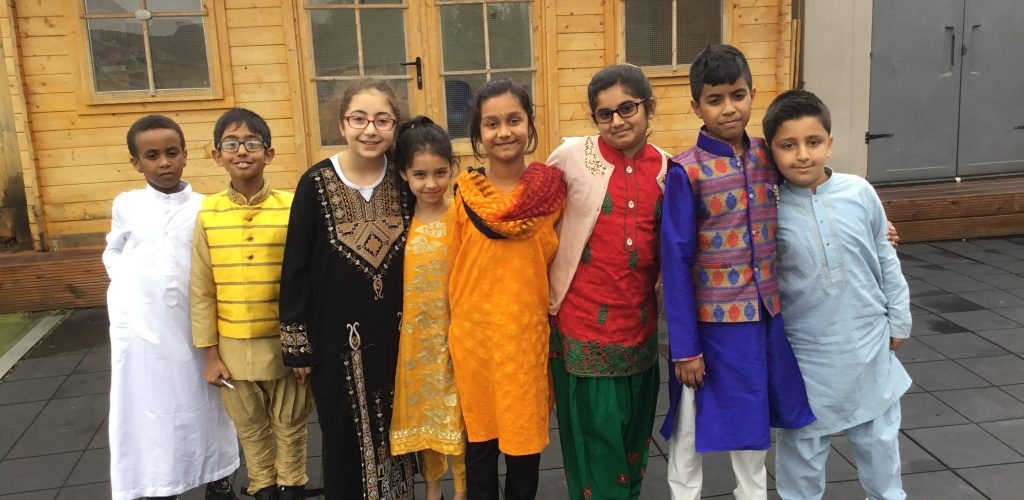 students wearing traditional Indian clothing